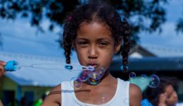 girl-blowing-bubbles12x6