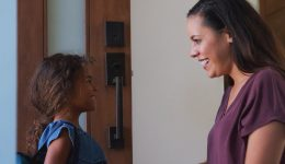 mother-giving-daughter-high-five-as-she-leaves-home-for-school