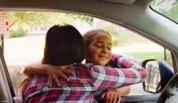 mother-in-car-dropping-off-daughter-in-front-of-school